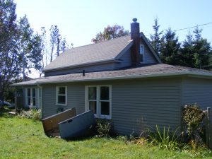 Home Renovations: Before photo of Siding Replacement project