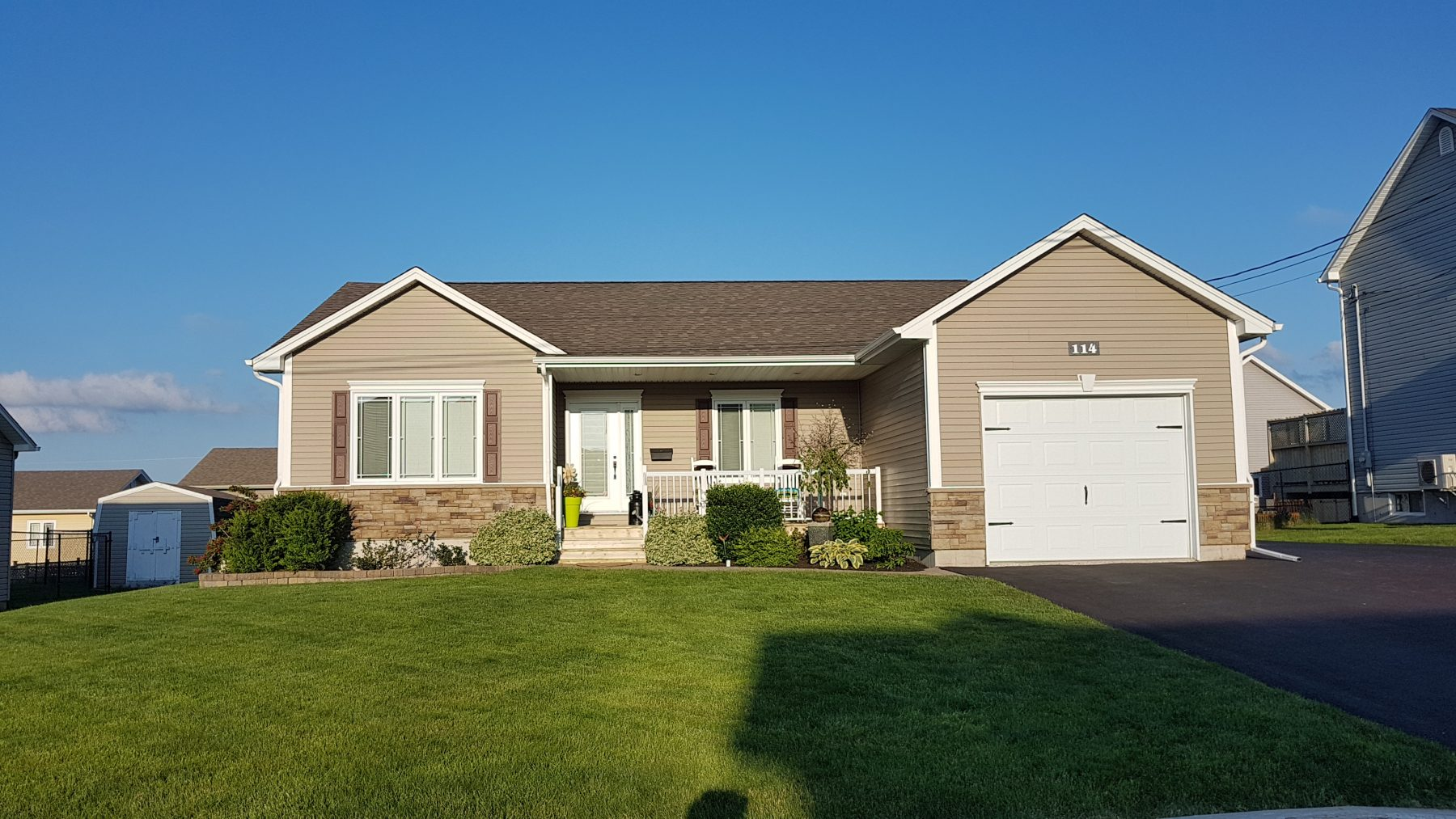 After Photo: Home Renovation Project, Siding, Railings, and Shutters